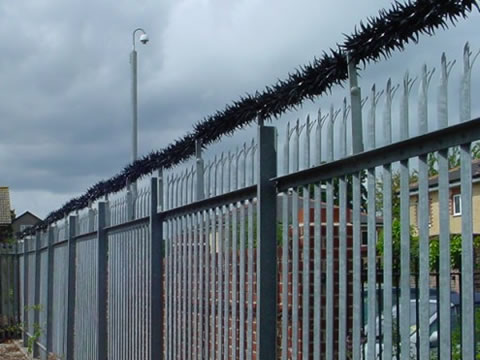 Wall spikes are installed at the top of galvanized palisade fences in the residence.